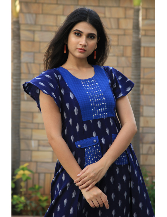 BLUE IKAT PLEATED DRESS WITH EMBROIDERED POCKETS AND YOKE: LD550B-M-1