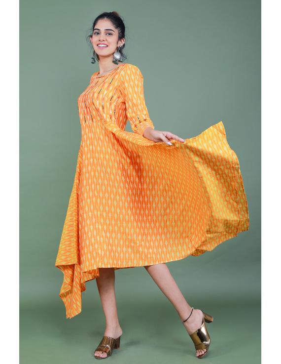 Golden yellow semi silk ikat dress with a handkerchief hem: LD500C-M-1