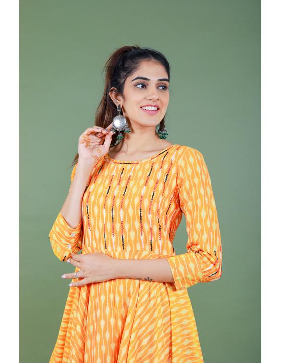 Golden yellow semi silk ikat dress with a handkerchief hem: LD500C-M-2