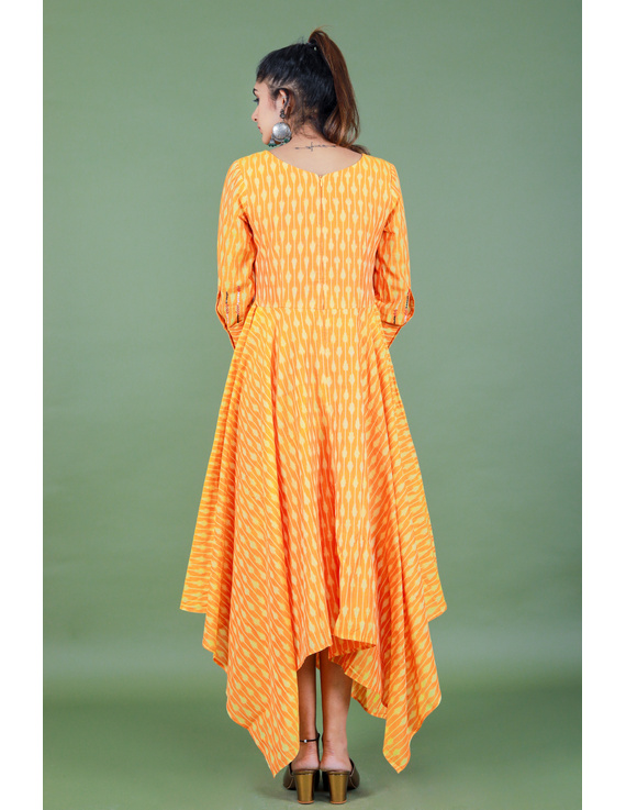 Golden yellow semi silk ikat dress with a handkerchief hem: LD500C-M-3