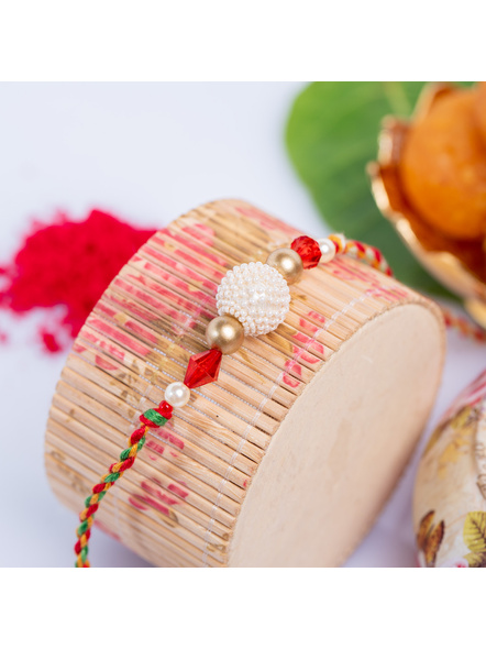 Handmade Pearl Focal Red Crystal Designer Rakhi with Roli Chawal-LAA-RK-22
