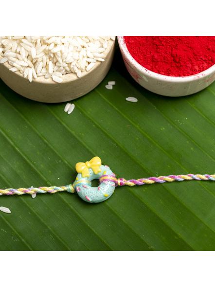 Acrylic Mint Green Doughnut Rakhi with Pastel Multicolor Dori Roli Chawal for Boys & Kids-1