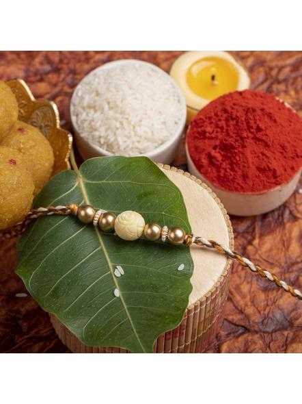 Handmade Beige Carved Bead Focal Golden Rakhi for Men and Boys with Roli Chawal-LAARK01