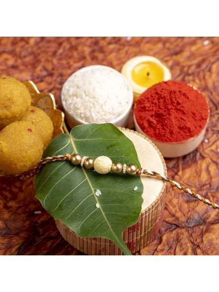 Handmade Beige Carved Bead Focal Golden Rakhi for Men and Boys with Roli Chawal-2