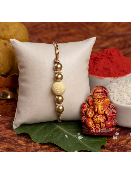 Handmade Beige Carved Bead Focal Golden Rakhi for Men and Boys with Roli Chawal-1