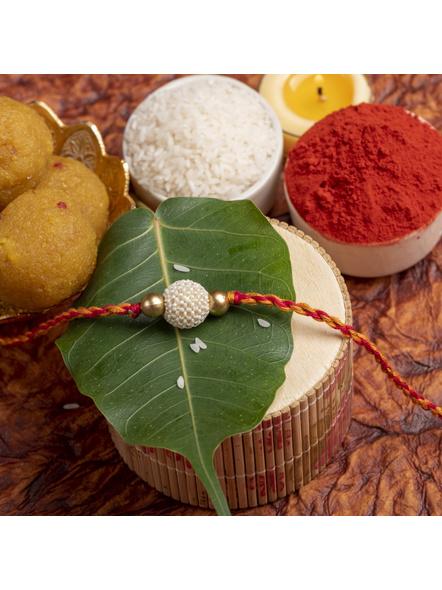 Handmade Beaded Pearl Golden Rakhi for Men and Boys with Roli Chawal-LAARK02