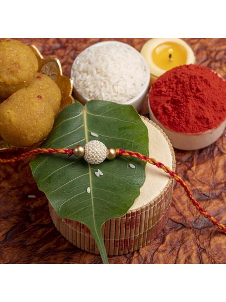 Handmade Beaded Pearl Golden Rakhi for Men and Boys with Roli Chawal-2