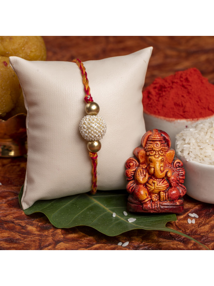 Handmade Beaded Pearl Golden Rakhi for Men and Boys with Roli Chawal-1