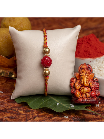 Handmade Red Carved Bead Focal Golden Rakhi for Men and Boys with Roli Chawal-1