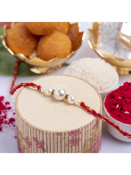 Handmade Designer Shell Pearl Rakhi with Roli Chawal-1