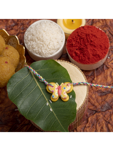 Acrylic Yellow Butterfly Rakhi with Yellow Pink Blue Dori Roli Chawal for Boys & Kids-LAARKK17