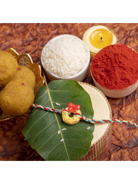 Acrylic Yellow Doughnut Rakhi Yellow Red Dori Roli Chawal for Kids-1